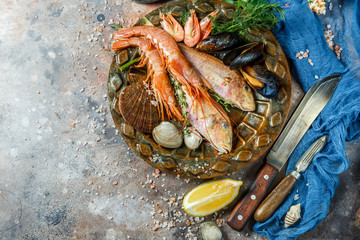 Seafood with lemon, knives, seashells