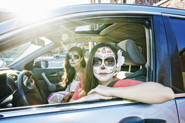 Women in car wearing skull face paint