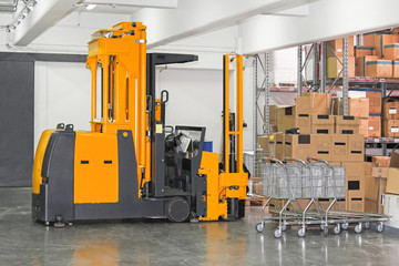 Stacker forklift in warehouse