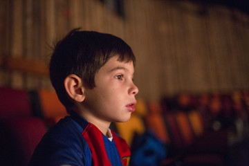 Mixed Race boy watching movie in theater