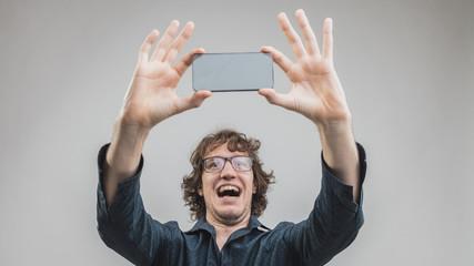very happy man making a selfie