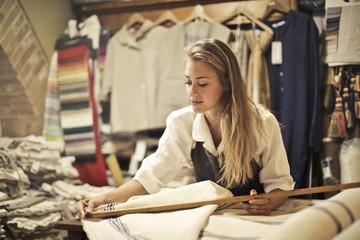 Dressmaker in her boutique