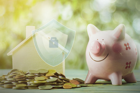 protection finance about home and house and money concept with stacked of coin