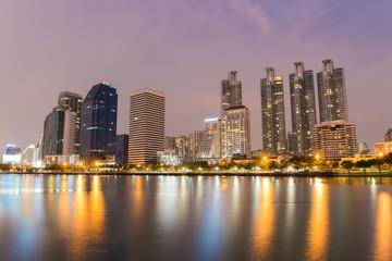 Bangkok city downtown at twilight time with reflection of skyline at Bangkok,Thailand