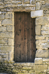 Vintage old wooden door in a Town of spain