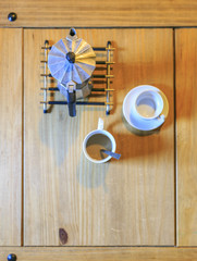 white Cofee cup in a wooden table