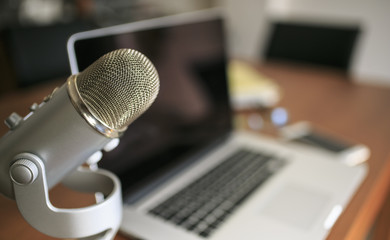 Laptop and mic a a wooden table