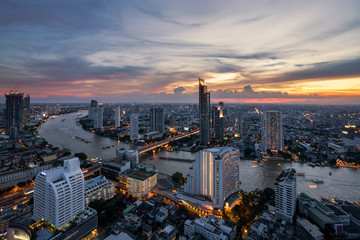 Landscape of Chao phraya river in Bangkok city in evening time with bird view. Bangkok City at night time, Hotel and resident area in the capital of Thailand.