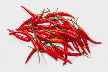 red chilli pepper on white board