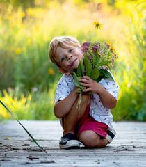 Child Holding Freshly Pick Wild Flowers