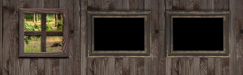 Wooden wall with  photo frames and forest outside the window