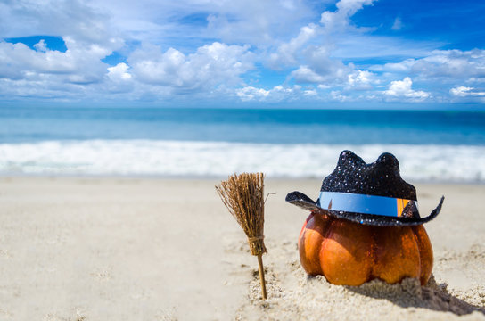 Halloween pumpkin background on the beach