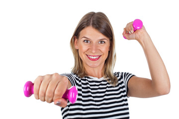 Smiling woman with pink dumbbells