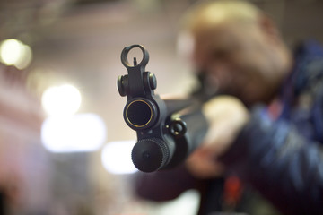 Man shooting skeet with a shotgun. Selected focus.