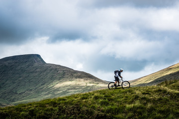 Mountain biking in the Brecon Beacons - lone rider against an epic view