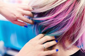 Hands in rainbow hair