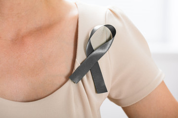 Woman With Grey Ribbon To Support Breast Cancer Cause