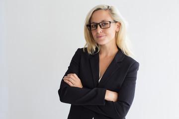 Portrait of confident female leader in eyeglasses