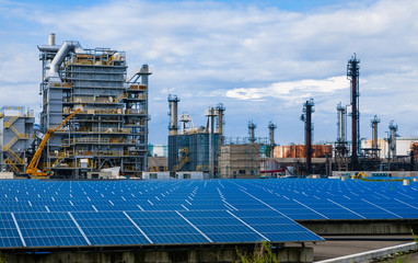 industrial buildings and solar panels. renewable energy concept.