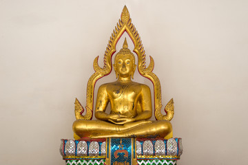 Golden buddha statue in sitting posture with aura near his body