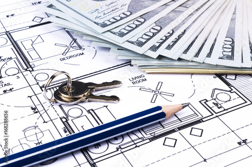 Stack of money with key lying on construction drawing of house stack of money with key lying on construction drawing of house blueprint house plan concept malvernweather Images
