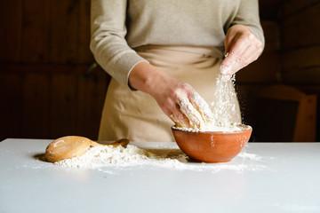 Close up of a female kneading dough for homemade bread.