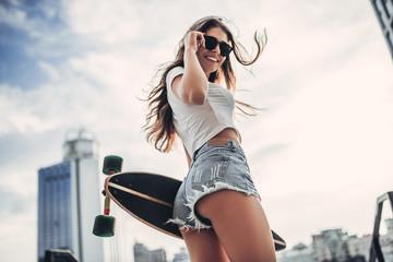 Female teenager with skateboard
