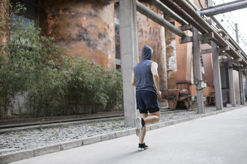 Young man jogging outdoors