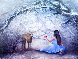 Girl with deer in winter
