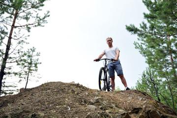 Athlete on a mountain bike on the rise. Healthy lifestyle