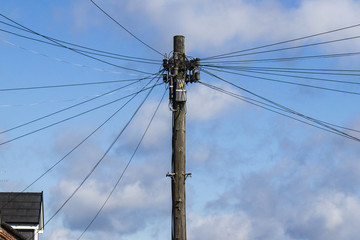 Telegraph pole with many cables