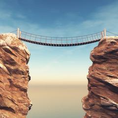 Old bridge over between two big rocks