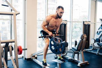 Muscular guy in the gym