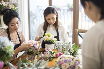 Young women learning flower arrangement