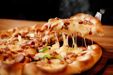 Hot pizza cheese crust seafood topping sauce vegetables delicious fast food