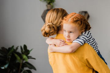 mother and daughter embracing