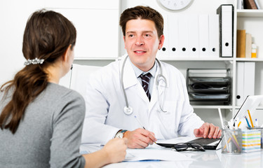 Doctor with patient sitting at the table