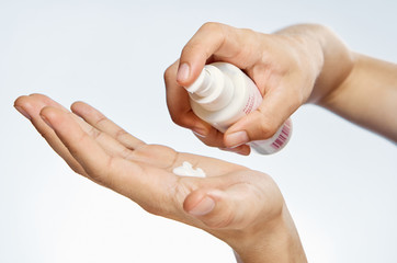 Hands, cosmetic cream, white isolated background, skin care