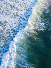 Aerial view of incoming breaking waves.