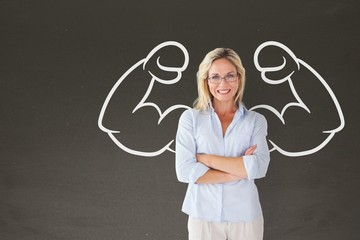 Happy student woman with fists graphic standing against grey bla