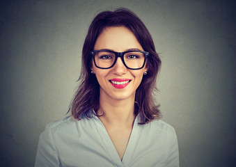 Happy cute young woman in glasses