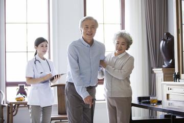 Nursing assistant and senior couple