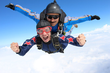 Skydiving. Tandem jump. Happy Passenger.