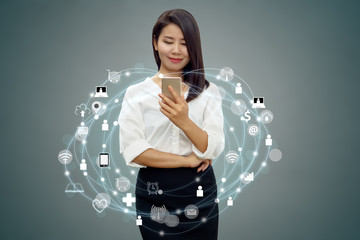 Asian woman using smart phone connecting to internet with icon social media and modern technology background