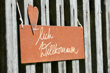 Sign on the fence close up photo