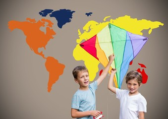 Kids holding kite in front of colorful world map