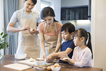 Happy young family baking together