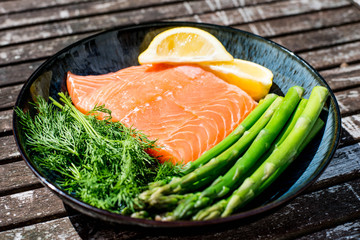 Fresh Healthy Salmon Fillet With Asparagus and Herbs
