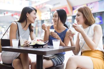 Best female friends sitting at sidewalk café
