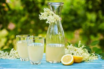 Two glasses and a carafe of elderflower lemonade